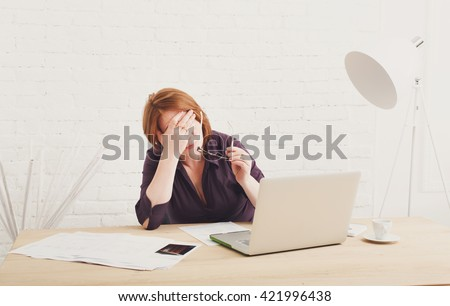 Depressed and upset businesswoman in her office. Middle aged woman sad, frustrated  - stock photo