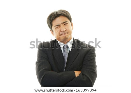 Depressed Asian businessman.