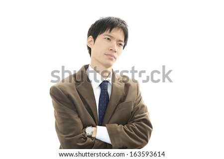 Depressed Asian businessman. - stock photo