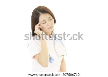 Depressed Asian female nurse