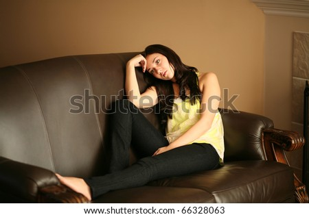 depressed beautiful young female model looking away from camera - stock photo