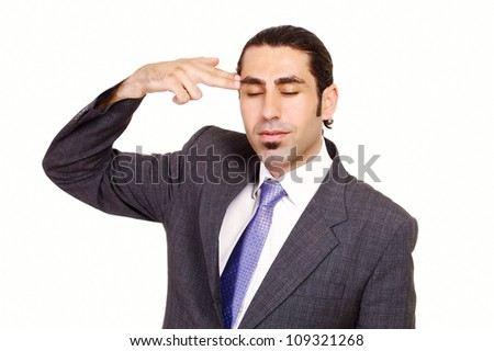 Depressed businessman points hand gun to head