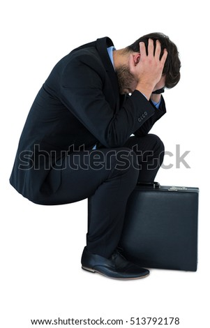 Depressed businessman sitting on steps on white background