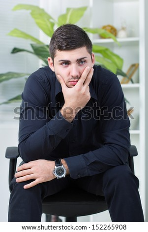 depressed bussinesman worried  about too much work - stock photo