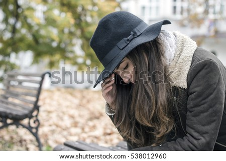 depressed female in autumn season. Portrait of a young woman's profile looking lonely. sad woman.