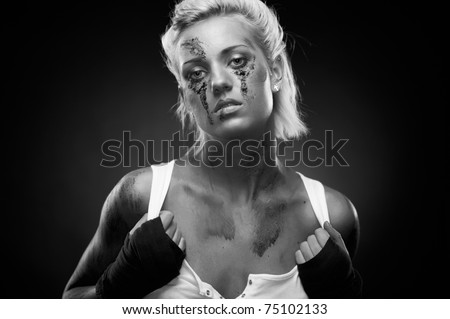 Depressed girl with dirt on her face, closeup. Studio shot. - stock photo