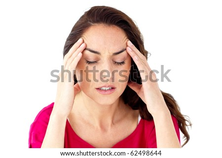 Depressed hispanic woman having a headache against a white background