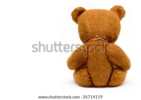 Depressed lonely old teddy isolated - stock photo