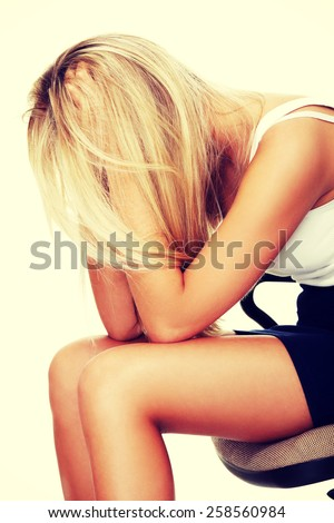 Depressed lonely woman with head in hands. - stock photo