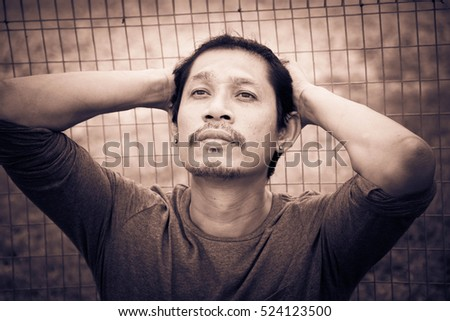 Depressed man sitting,Young handsome man thinking,Sad,Sepia