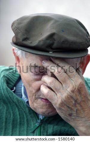Depressed old man - stock photo