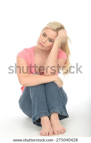 Depressed Sad Unhappy Young Woman in Her Twenties Sitting Alone on the Floor Looking Miserable - stock photo
