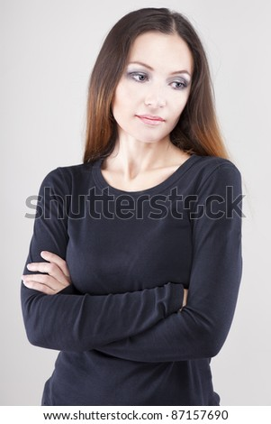 Depressed, sad woman on neutral background
