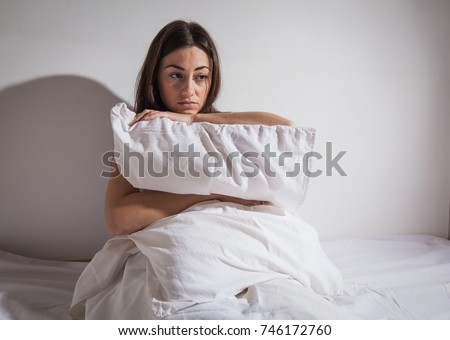 Depressed sleepless young woman suffering from insomnia.