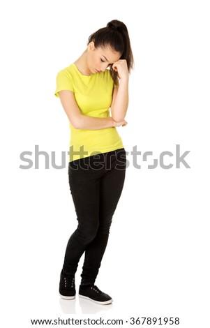 Depressed teen woman touching head. - stock photo