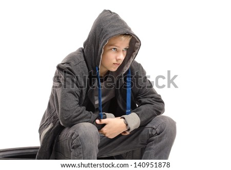 Depressed teenage boy in a jacket. Isolated on white background - stock photo