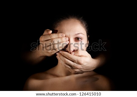 depressed woman being held silent by male hands - stock photo