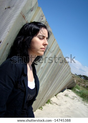 Depressed Woman - I need to rest in this beach it fells like the word is crashing me