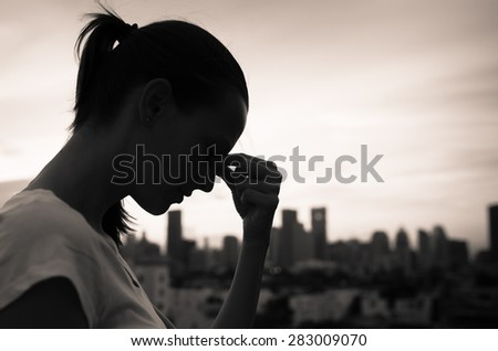 Depressed woman in the city.  - stock photo