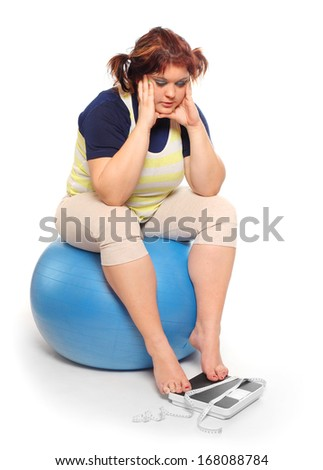 Depressed woman with measure tape and weighing machine.  - stock photo