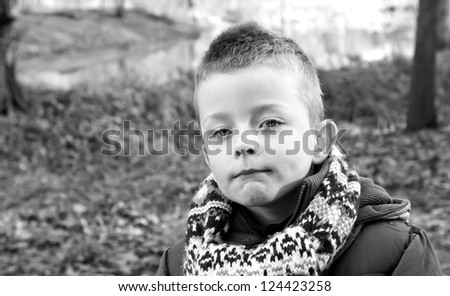 Depressed young boy looking directly ahead - stock photo