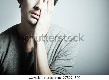 Depressed young man. - stock photo