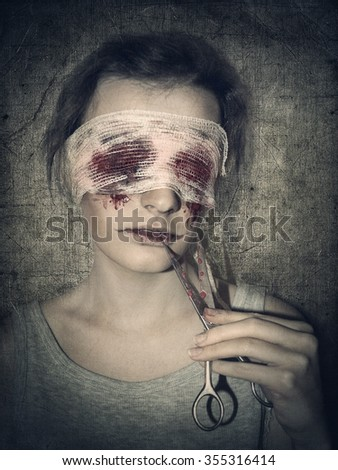 Depression and bloody Halloween theme: maimed, blind woman holding bloody scissors.  - stock photo