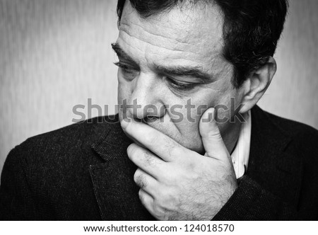 Depression: black and white portrait of a sad man. Series - stock photo