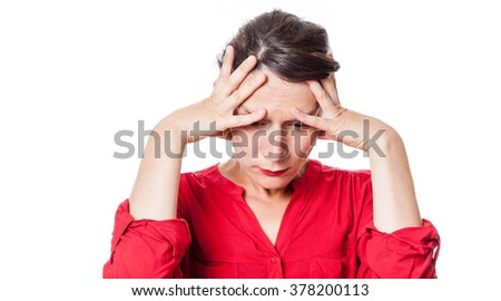 depression concept - concerned young woman suffering from a headache, seeking for inspiration or feeling desperate, white background studio