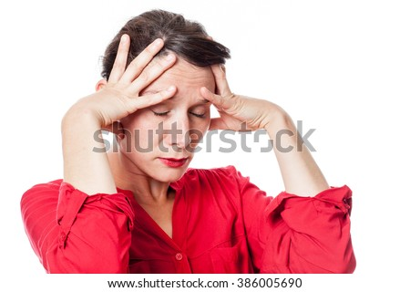 depression concept - exasperated young woman touching her brain with exhaustion for headache, inspiration or despair, white background studio - stock photo