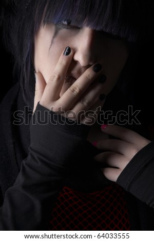 Depression of the young girl on a black background