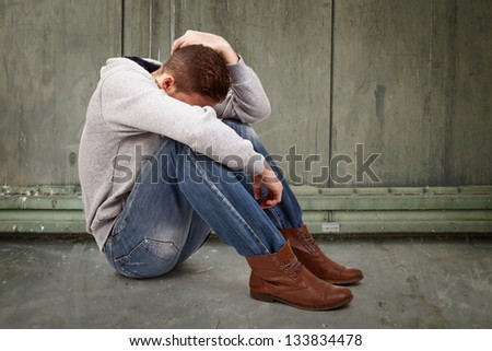depressive young man - stock photo