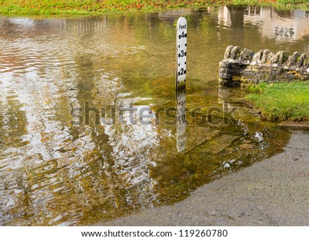 Depth gauge at deep river at road ford on Shill Brook at Shilton Oxfordshire - stock photo