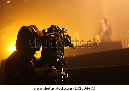 Depth of field image of an unidentified cameraman at an unknown concert in Tokyo, Japan - stock photo