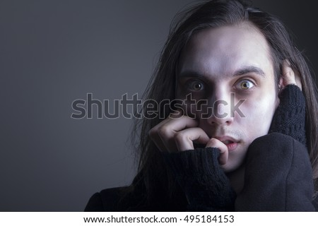 Deranged caucasian male, long hair, crazy eyes and pale skin, British gothic