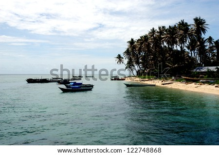 DERAWAN island one tourist attraction in the eastern Borneo province of Indonesia - stock photo