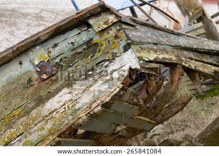 Derelict and rotting wooden boat on River Taw, Fremington, Devon, England - stock photo