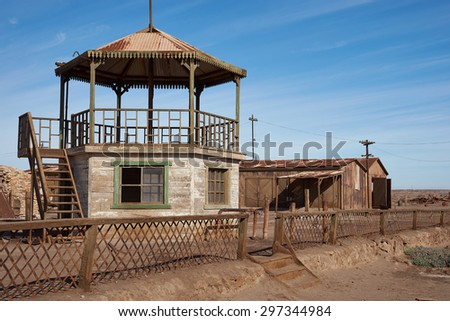 Derelict and rusting bandstand at the historic Humberstone Saltpeter Works in the Atacama Desert near Iquique in Chile. The site is now an open air museum and a Unesco World Heritage SIte. - stock photo