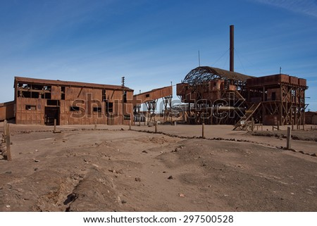 Derelict and rusting leaching plant at the historic Santa Laura Saltpeter Works in the Atacama Desert near Iquique in Chile. The site is now an open air museum and a Unesco World Heritage SIte. - stock photo