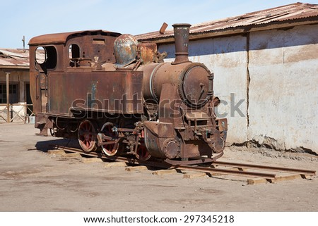 Derelict and rusting steam train at the historic Humberstone Saltpeter Works in the Atacama Desert near Iquique in Chile. The site is now an open air museum and a Unesco World Heritage SIte. - stock photo