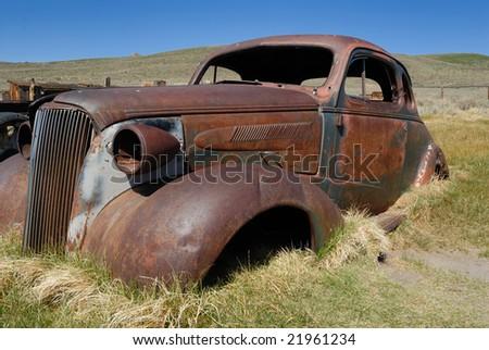 Derelict automobile in Bodie California - stock photo