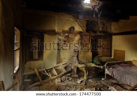 Derelict bedroom in an abandoned house in an old village in Bulgaria - stock photo