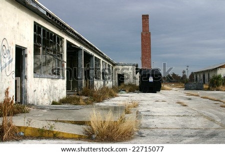 Derelict warehouse building shot against a darkening sky on former Orlando Naval Air Station - stock photo
