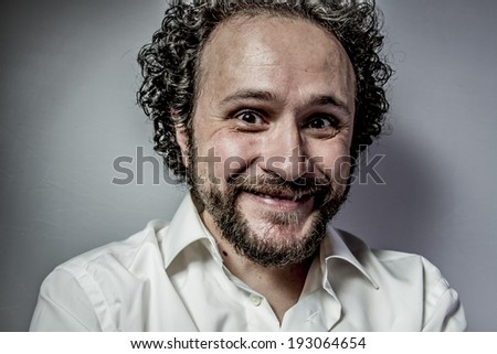 derision, man with intense expression, white shirt - stock photo