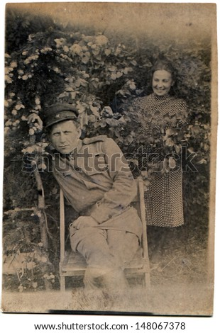 DERMANY - CIRCA MAY 1945: Vintage photo shows man and woman - Soviet Army soldiers, Germany, May, 1945 - stock photo