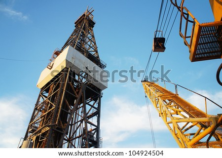 Derrick of Jack Up Oil Drilling Rig and Rig Crane - stock photo