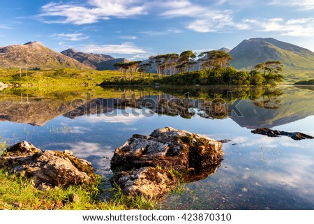 Derryclare Lough, Connemara mountains in the background in Ireland.  - stock photo