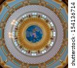 DES MOINES, IOWA - AUGUST 19: Interior dome from the rotunda of the Iowa State Capitol building on August 19, 2013 in Des Moines, Iowa - stock photo