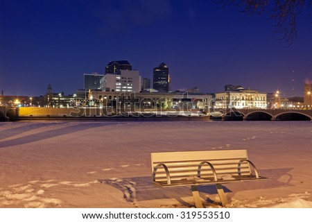 Des Moines skyline with snowy background. Des Moines, Iowa, USA. - stock photo