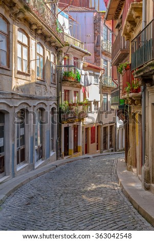 Descent old alley in downtown Porto. - stock photo